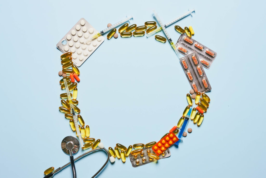 Circle made of medical pills and capsules with copy space in the center