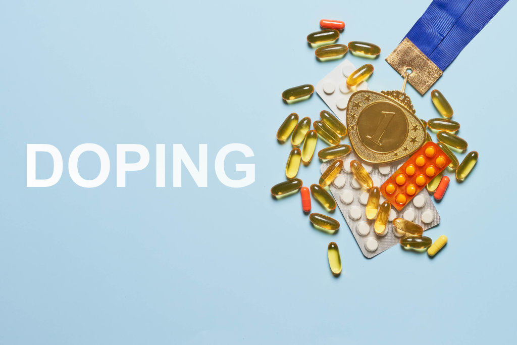 Doping for athletes - Gold medal and doping pills with capsules on a blue background