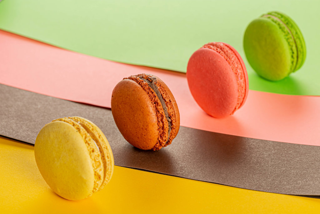 Colorful dessert background with multicolored macaroons