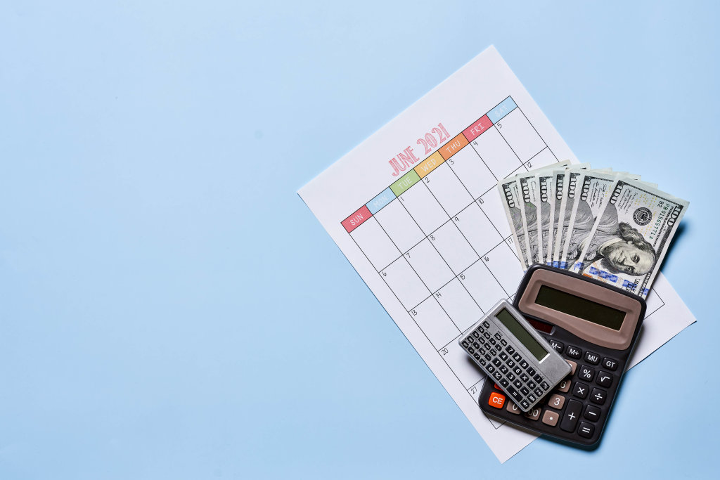 Time to pay the bills. US dollars and monthly calendar
