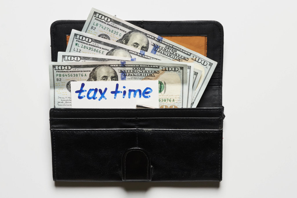 Tax time - a wallet with us dollars and note