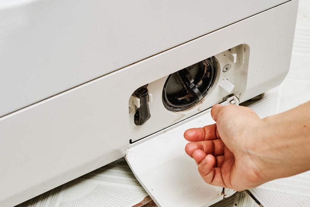 Opening debris filter on washing machine
