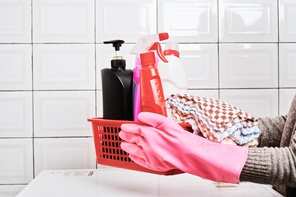 Woman with basket of cleaning supplies