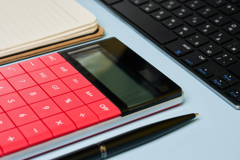 Accountants working place with calculator and notepad