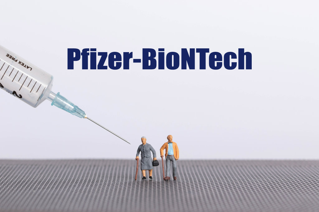 Older couple with syringe and Pfizer-BioNTech text