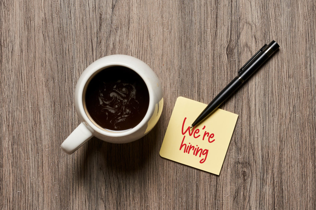 We are hiring on sticky note and coffee mug