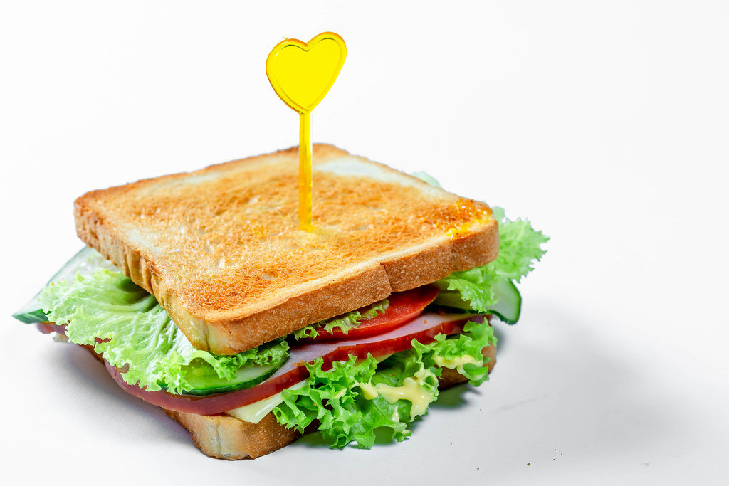 Delicious toast on a white background. The concept of fast food