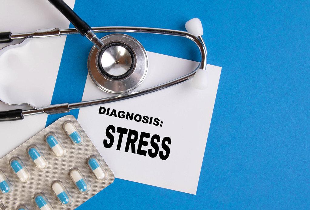 Diagnosis Stress written on medical blue folder