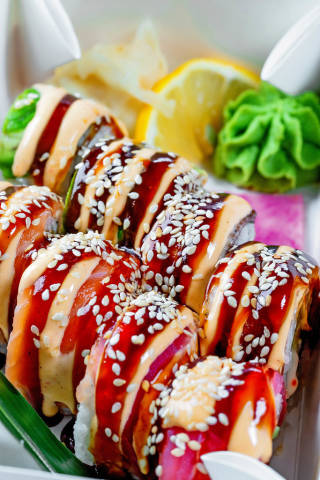 Delicious sushi with lemon, wasabi and ginger