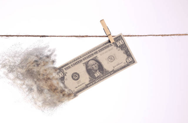 Dollar banknote with smoke hanging on clothes line
