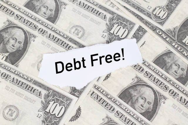 Note with Debt Free! text on dollar banknotes