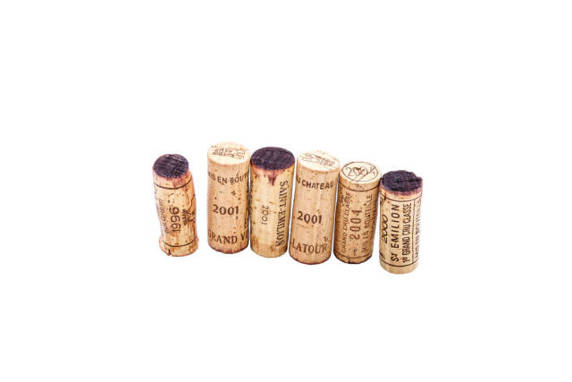 Few rare wine corks on white background