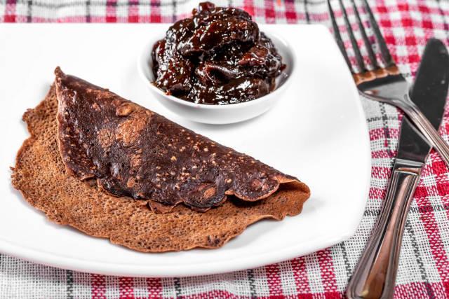 Chocolate pancake with jam and Cutlery