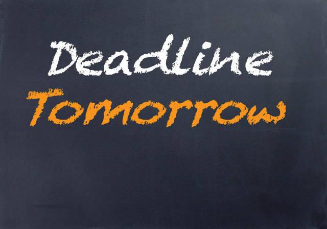 Deadline tomorrow chalk text on blackboard