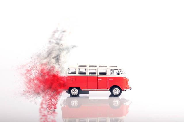 Red vintage camper van moving fast