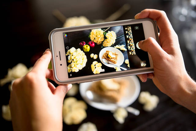 Close Up Photo of Person taking a Food Photo with a Smartphone