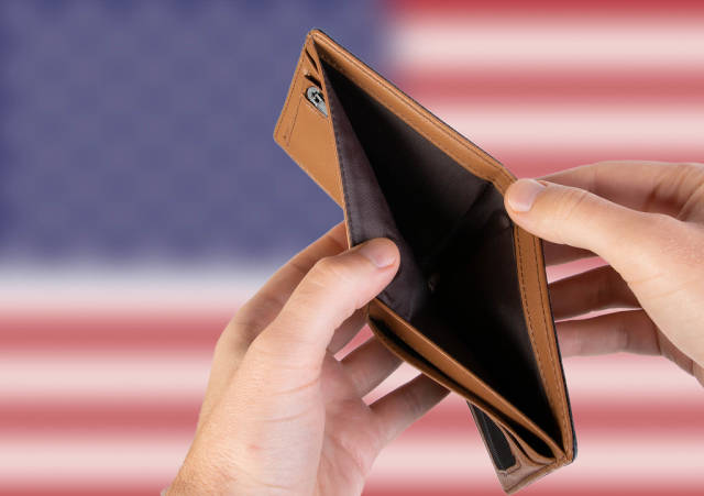 Empty Wallet with Flag of USA. Recession and Financial Crisis to come with more debt and federal budget deficit?
