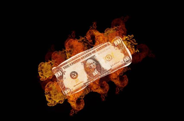 Burning dollar banknote