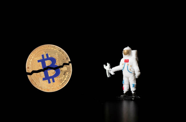 Astronaut with with broken Bitcoin