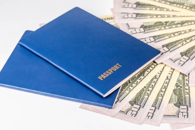 Two passport and money, American dollars banknotes bills on white background