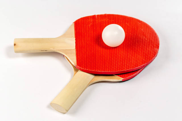 Tennis ball with two rackets for table tennis