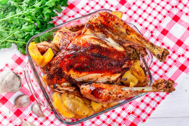 Roasted chicken on table, top view