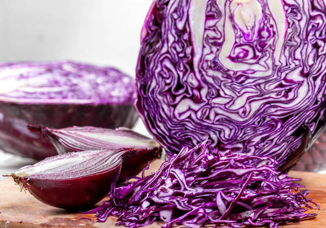 Red cabbage and onions cut close-up