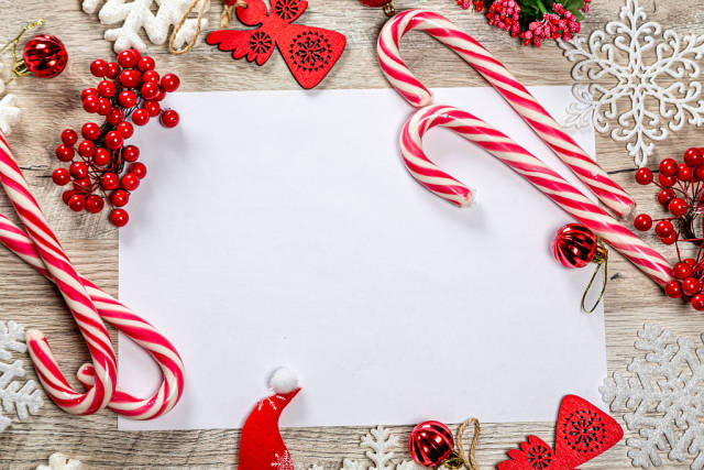 Top View Photo of Blank Paper on Wooden Table with different Christmas Decorations around it