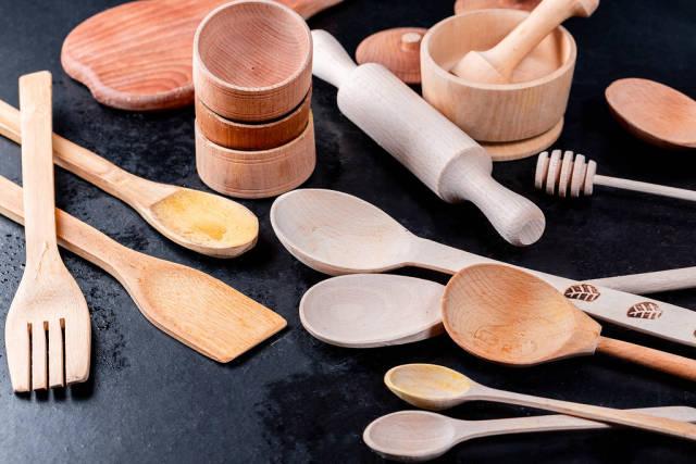 Home wooden kitchen utensils on a dark background