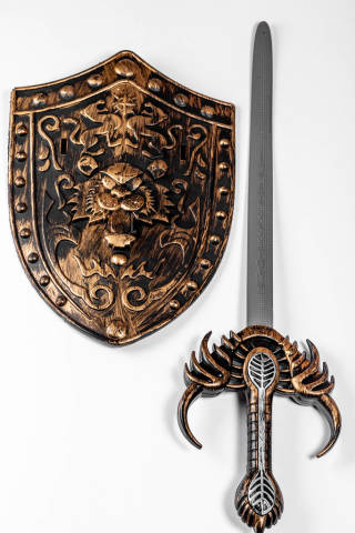 Toy shield and sword on white background