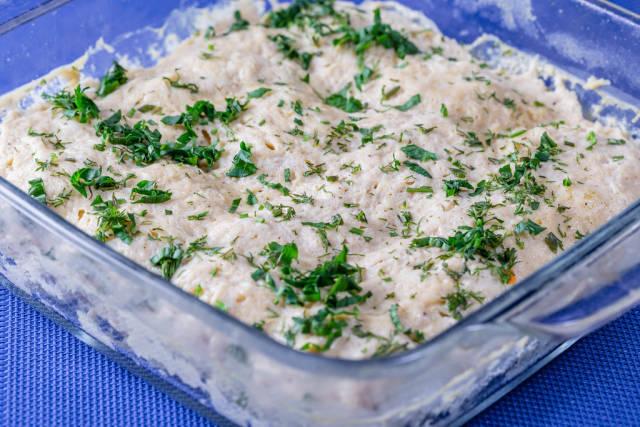 Meat casserole in spicy yogurt sauce on blue background