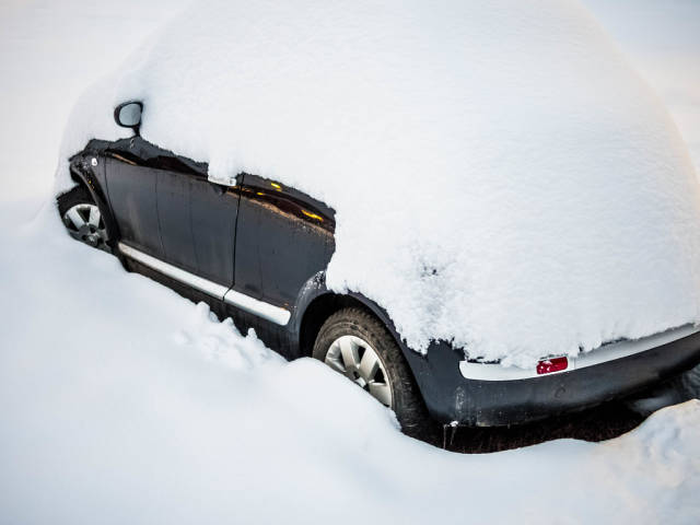 Car stuck in snow after a blizzard