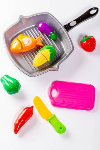 Plastic childrens toys vegetables, frying pan, knife and tray