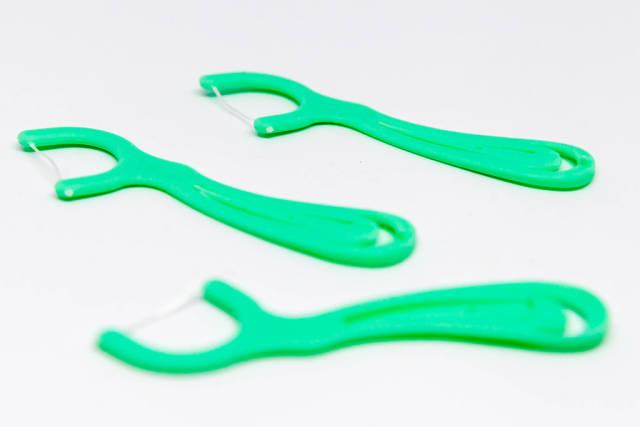 Türkisfarbene Zahnseide-Sticks
