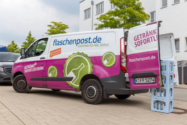 German pun on a delivery white-pink van of a beverage supplier in the city