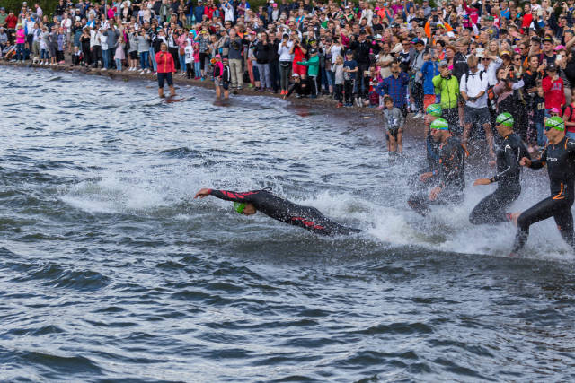 After a rolling start of the Ironman 70.3 in Lahti, north of Helsinki, the triathlon athletes are competing in a swimming race