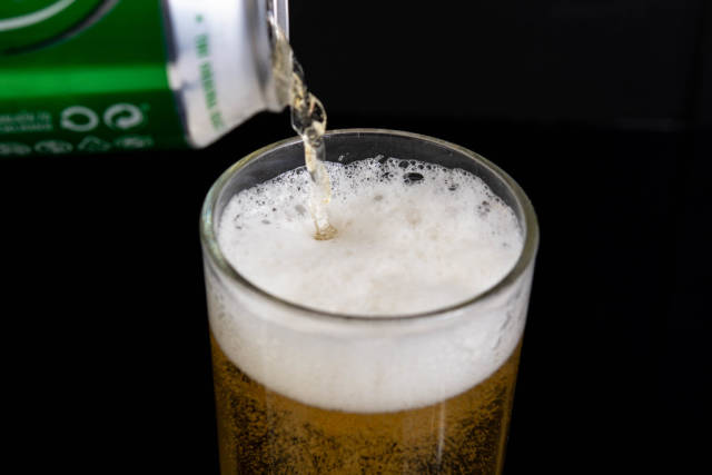 Pouring Heineken Canned Beer in the glass