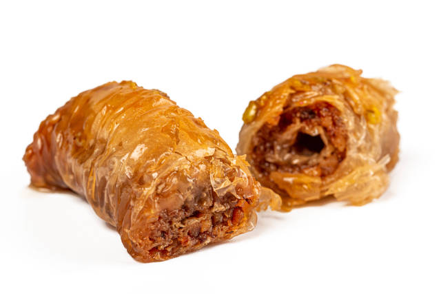 Oriental sweets, baklava with walnut and pistachio, close up