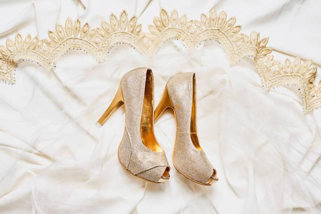Luxury bridal shoes on wedding dress