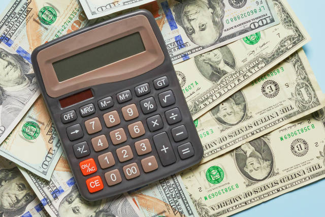 Business concept - calculator on money background