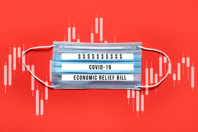 COVID-19 - Economic relief bill written on the medical face mask