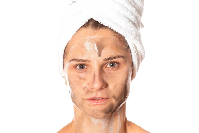 Portrait of a girl caring for her face, a cosmetic mask is applied to the skin
