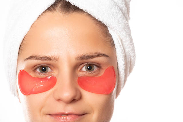 Girl portrait with collagen pads under her eyes, close up