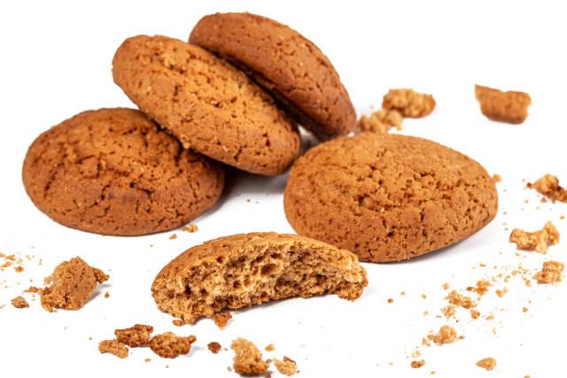 Fresh oatmeal cookies on a white background