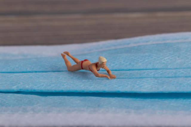 Miniature swimer on a medical face mask