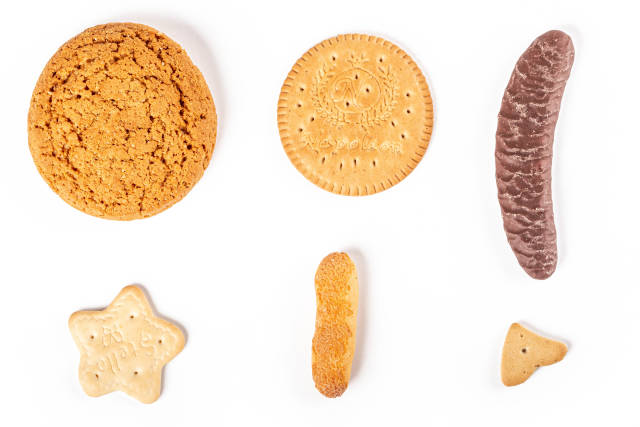 Top view, set of assorted cookies on white