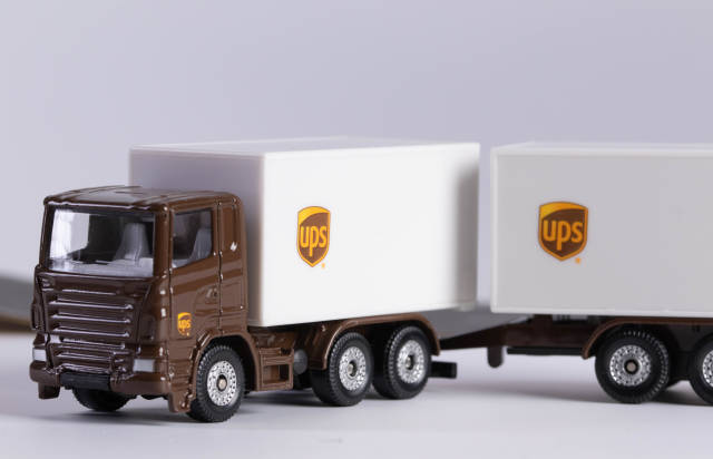UPS delivery truck with white background