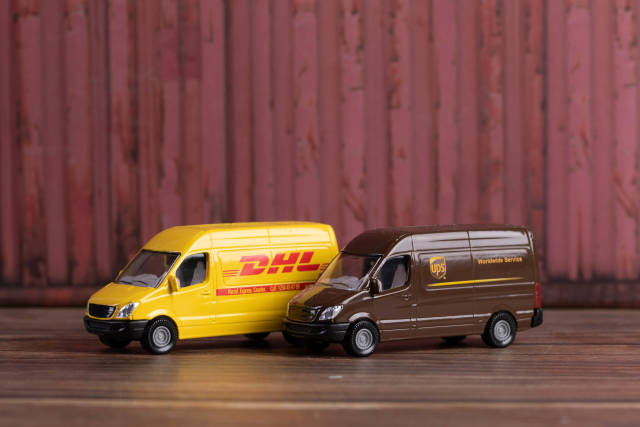 DHL and UPS sign Delivery Trucks