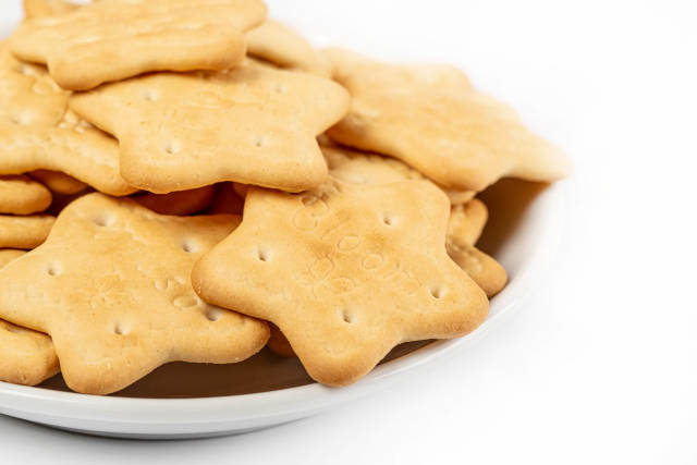 Star-shaped cookies on a white saucer