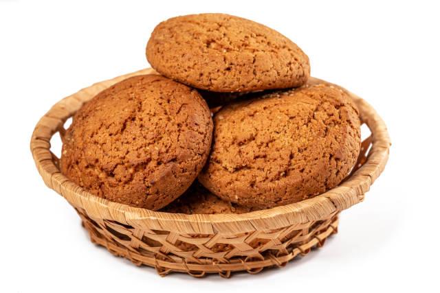 Homemade baking - oatmeal cookies in wicker basket